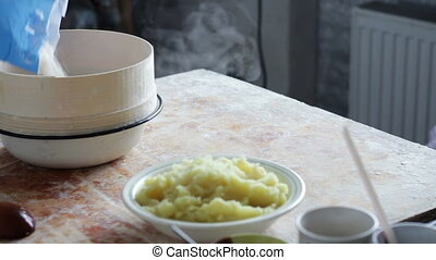 Prepares the Dough on Domestic Kitchen - Woman cook on the...