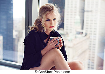 woman holding coffee cup - Beautiful young adult woman...
