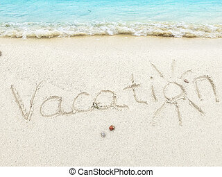 "Inscription "" Vacations"" in the sand on a tropical island,  Maldives."
