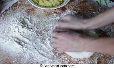 Woman Prepares the Dough on Domestic Kitchen - Woman cook on...