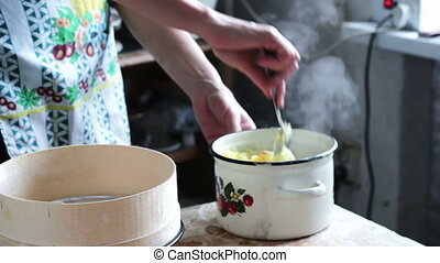 Woman Preparing Mashed Potatoes in the Home Kitchen - Woman...