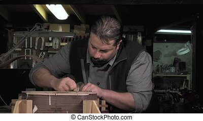 Master luthier guitars at work - surfacing inlaid soundboard...