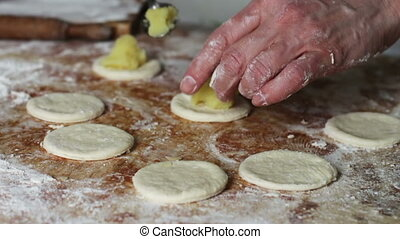 Woman Prepares Dough for Dumplings at Home Kitchen - Woman...
