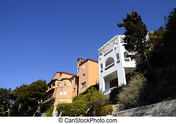 Provencal colored homes in Bandol, France - Orange and white...