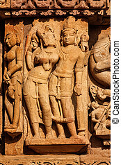 Sculptures on Adinath Jain Temple, Khajuraho - Stone carving...