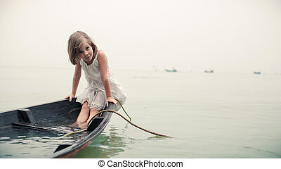 Beautiful young girl in the sinking boat. - Beautiful young...
