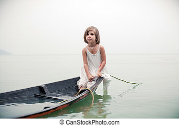 Beautiful young girl in the sinking boat - Beautiful young...