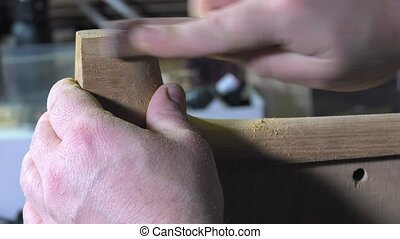 Master luthier guitars at work - shaping the back of the...