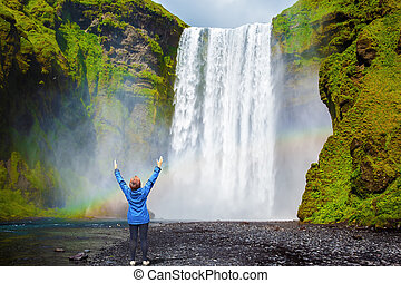 Middle-aged woman - tourist shocked beauty waterfall -...