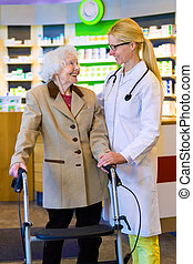 Friendly doctor with patient using walker - Friendly female...