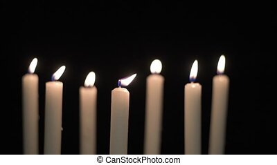 Seven candles dancing - Seven candles with dancing flames on...