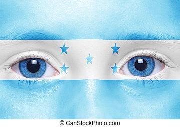 human's face with honduran flag