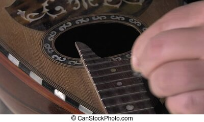 Master luthier guitars at work - cleaning button and the...