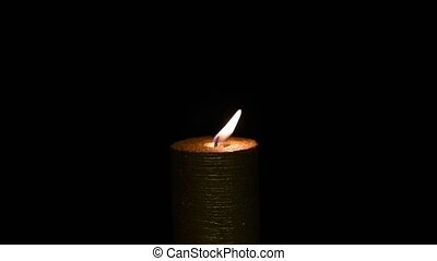 Candle on a dark background