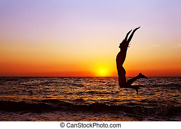 silhouette of a man at sunset - silhouette of a happy man...