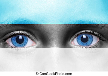 humans face with estonian flag