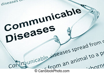 communicable diseases - Paper with words communicable...
