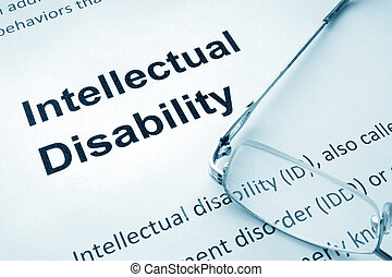 intellectual disability - Paper with words intellectual...