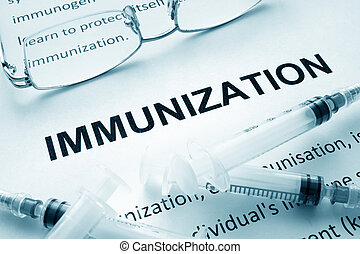 immunization - Paper with word immunization and glasses.