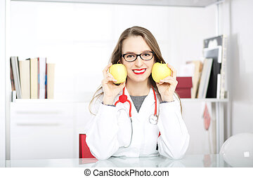 Smiling nutritionist writing medical records with fresh...