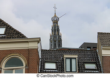 The bell tower of the Grote Kerk (Sint-Bavokerk) over the...