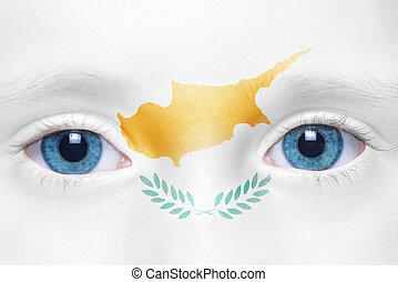 child's face with cypriot flag