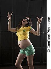 brazilian fan pregnant woman - pregnant woman happy fan of...