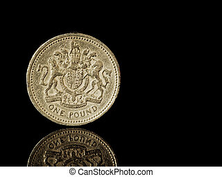 Old and worn UK one pound coin. Sterling. Mirrored on...