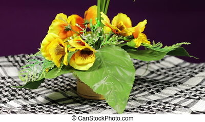 Artificial Flower Rotates - Artificial flower on a wooden...
