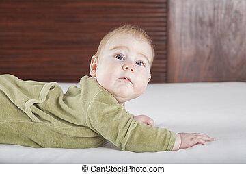 baby green onesie looking surprised - six months age blonde...