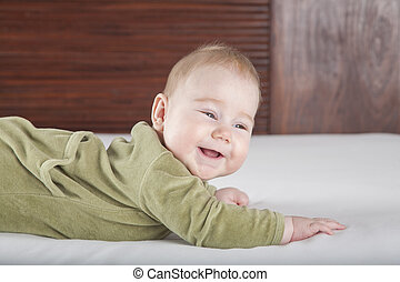 baby green onesie smiling - six months age blonde baby green...