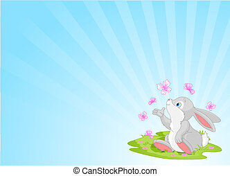 Easter Bunny background - A cute Easter bunny sitting on the...