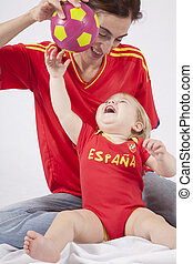 happy baby and mother spanish soccer fans - happy mother and...