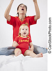 surprised baby and mother spanish soccer fans - surprised...