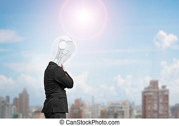 Man side view with lamp head thinking in sunny day, city...