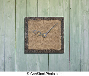 Old wooden board with clock hands