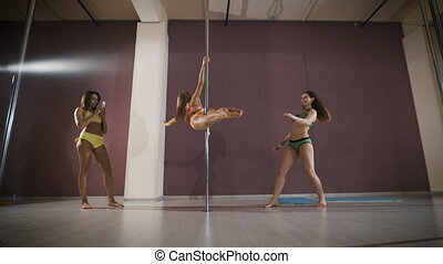 Girls having fun at a pole fitness class