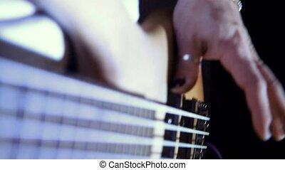 a man plays electric guitar