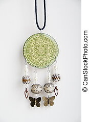The hand-painted pendant - Photo of hand-painted pendant on...