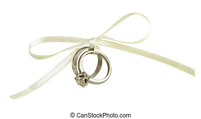 Wedding and engagement rings tied with white silk ribbon