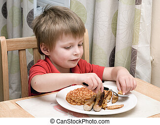 Young child eating unhealthy food.
