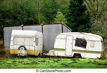 Abandoned motor homes in a field
