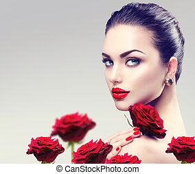 Beauty fashion model woman face. Portrait with red rose...