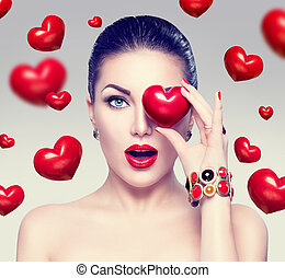 Fashion woman with red hearts. Valentine's day art portrait
