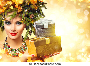 Winter woman holding New Year gifts