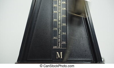 Vintage metronome, on a white background. - Color shot of a...