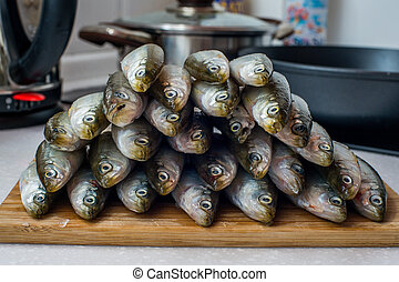 smelt fishes on white background - Fresh smelt fishes on...