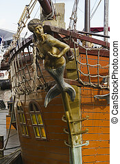 Mermaid figurehead on old sail ship Vintage retro style