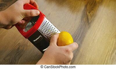 Lemon zest being grated 4k
