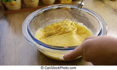 Closeup of mixing flour